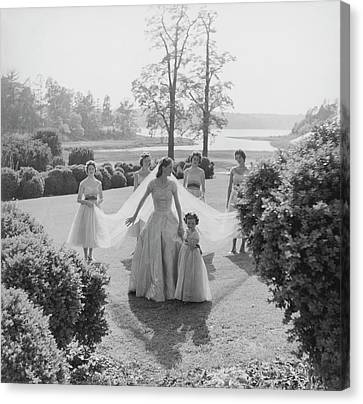 Wedding Dress Canvas Print - Sidney Bacon In Garden With Her Bridesmaids by Horst P. Horst