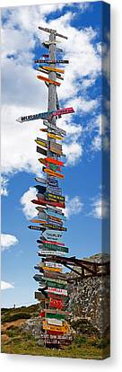 Sign Post Showing Distances To Various Canvas Print by Panoramic Images