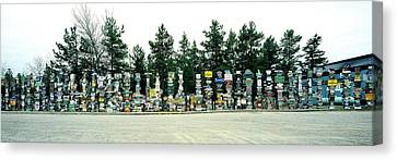 Signposts At The Roadside, Sign Post Canvas Print by Panoramic Images