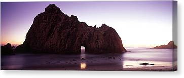 Silhouette Of A Cliff On The Beach Canvas Print