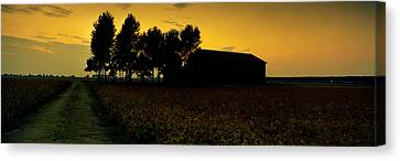 Silhouette Of A Farmhouse At Sunset Canvas Print by Panoramic Images
