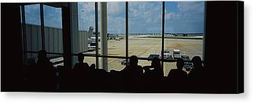 Silhouette Of A Group Of People At An Canvas Print by Panoramic Images