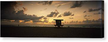 Silhouette Of A Lifeguard Hut Canvas Print by Panoramic Images