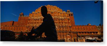 Silhouette Of A Person Riding Canvas Print by Panoramic Images