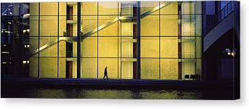 Haus Canvas Print - Silhouette Of A Person Walking In Front by Panoramic Images