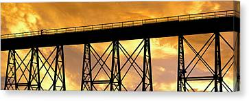 Silhouette Of A Railway Bridge Canvas Print by Panoramic Images