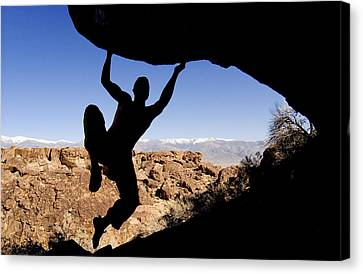 Silhouette Of A Rock Climber Canvas Print by Josh McCulloch