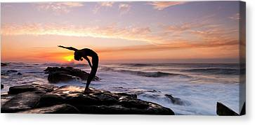 Silhouette Of A Woman Practicing Yoga Canvas Print by Panoramic Images