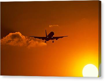 Silhouette Of Airliner In Golden Sunset Canvas Print by Panoramic Images