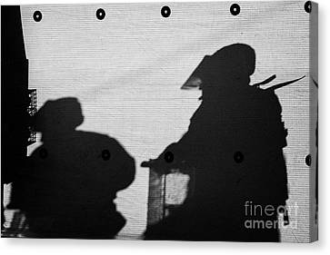 Terrorist Canvas Print - Silhouette Of British Army Soldiers On Screen On Crumlin Road At Ardoyne Shops Belfast 12th July by Joe Fox