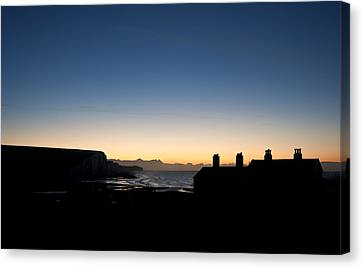 Silhouette Of Coastguard Cottages At Seaford Head At Sunrise Canvas Print by Matthew Gibson
