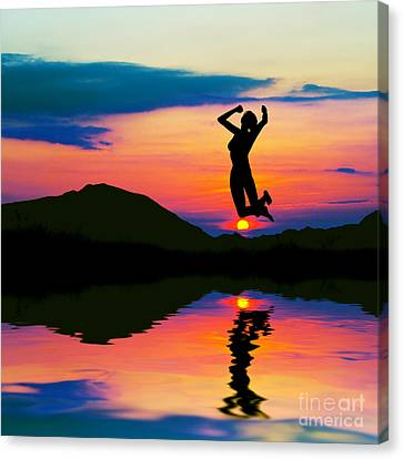 Silhouette Of Happy Woman Jumping At Sunset Canvas Print