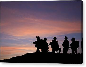 Silhouette Of Modern Troops In Middle East Silhouette Against Be Canvas Print by Matthew Gibson