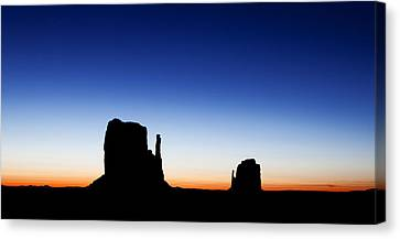 Silhouette Of The Mitten Buttes In Monument Valley  Canvas Print by Susan Schmitz
