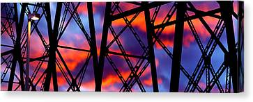Silhouette Of The Trestles Of A Railway Canvas Print by Panoramic Images