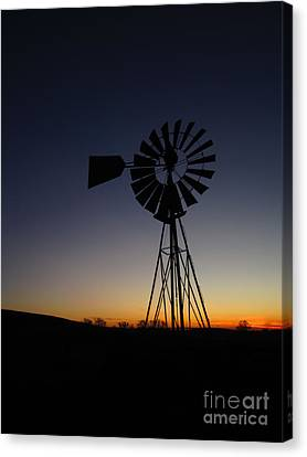Silhouetted Aermotor Canvas Print by Dan Julien