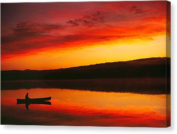 Silhouetted Canoe On Lake Canvas Print by Panoramic Images