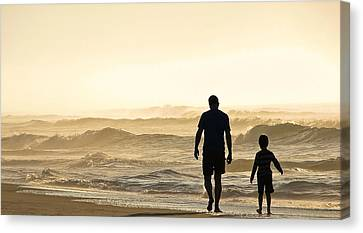 Silhouetted Father And Son Walk Beach  Canvas Print