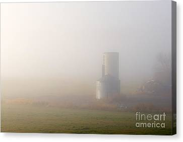 Silo In The Fog Canvas Print by Mike  Dawson