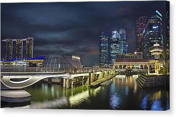 Singapore City By The Fullerton Pavilion At Night Canvas Print by David Gn