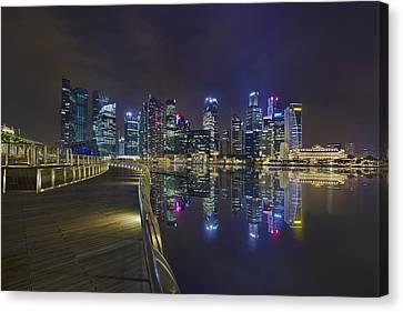 Singapore City Skyline Along Marina Bay Boardwalk At Night Canvas Print by David Gn