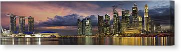 Singapore City Skyline At Sunset Panorama Canvas Print by Jit Lim