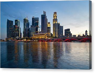 Singapore River Waterfront Skyline At Sunset Canvas Print by Jit Lim
