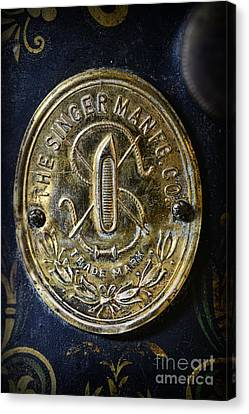 Singer Sewing Machine Badge Close Up Canvas Print by Paul Ward