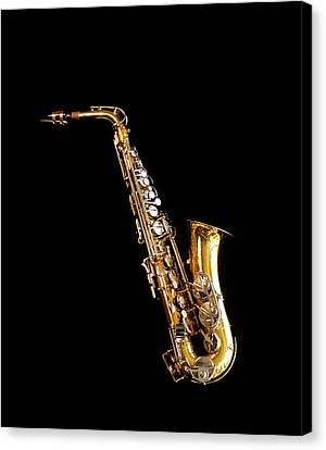 Jazzy Canvas Print - Single Saxophone Against Black by Vintage Images