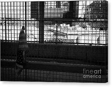 Single Small Memorial Us Flag Tied To The Fence At The World Trade Center Reconstruction Site  Canvas Print by Joe Fox