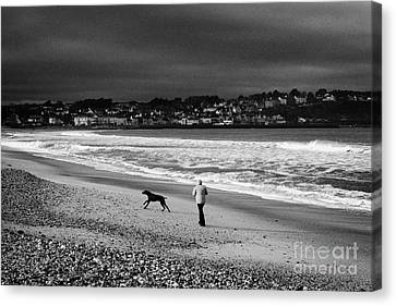Single Woman Out Walking Her Dog On Ballycastle Beach In Winter County Antrim Northern Ireland Canvas Print