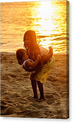 Sister And Brother On The Beach Canvas Print by Colin Utz