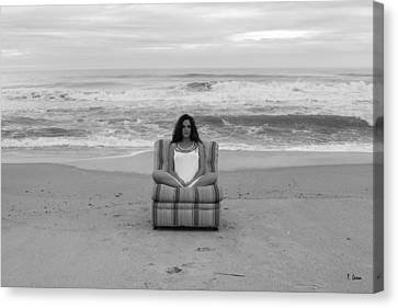 Sittinng On The Beach Canvas Print by Thomas Leon