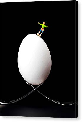 Skateboard Rolling On A Egg Canvas Print by Paul Ge