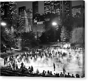 Canvas Print featuring the photograph New York City - Skating Rink - Monochrome by Dave Beckerman