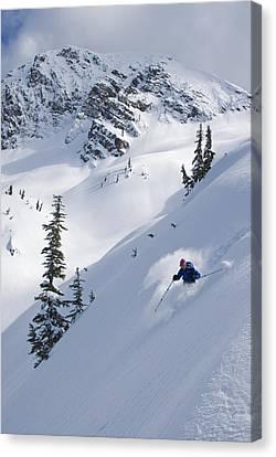 Skier Hitting Powder Below Nak Peak Canvas Print by Kurt Werby