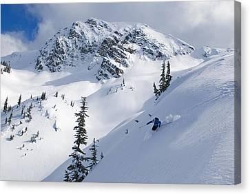 Skier Shredding Powder Below Nak Peak Canvas Print by Kurt Werby