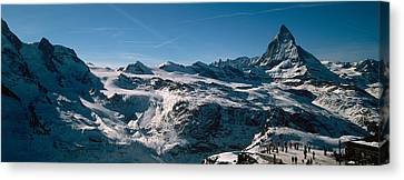Skiers On Mountains In Winter Canvas Print by Panoramic Images