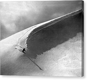 Skiing Under A Curl Canvas Print by Underwood Archives