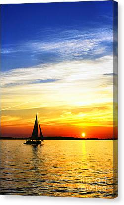Skipjack Under Full Sail At Sunset Canvas Print by Thomas R Fletcher