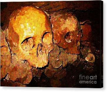 Skulls In The Paris Catacombs Canvas Print by John Malone