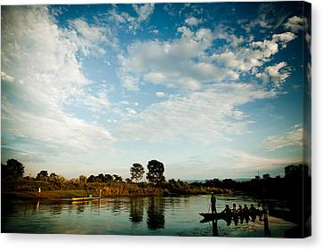 Tibetan Buddhism Canvas Print - Sky And River Wuth Boat by Raimond Klavins