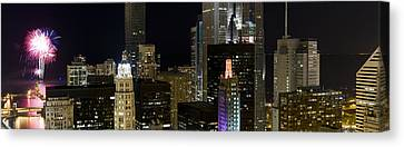Skyscrapers And Firework Display Canvas Print by Panoramic Images
