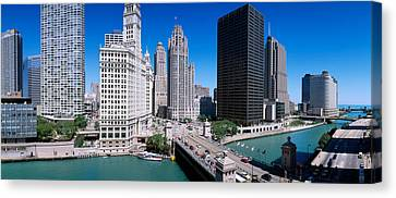 Skyscrapers In A City, Michigan Avenue Canvas Print by Panoramic Images