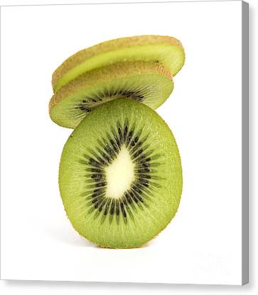 Sliced Kiwis Canvas Print by Bernard Jaubert