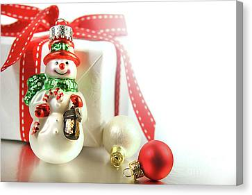 Snowman Canvas Print - Small Christmas Ornament With Gift by Sandra Cunningham