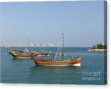 Small Dhows And Pearl Development Canvas Print by Paul Cowan
