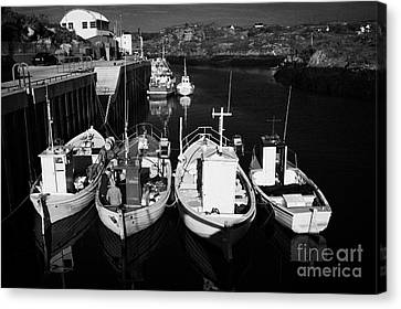 small fishing boats in bunbeg harbour county Donegal Republic of Ireland Canvas Print by Joe Fox