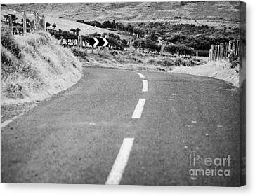Small Narrow Country Road Leading To Dangerous Bend In County Antrim Northern Ireland Canvas Print