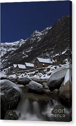 Small Village At Full Moon Canvas Print by Maurizio Bacciarini